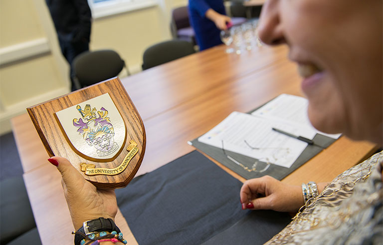 7. Olga Cosmidou was presented with a University of Manchester plaque