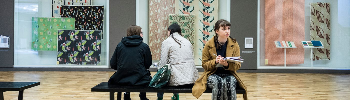 A female student sat in the Whitworth Art Gallery.
