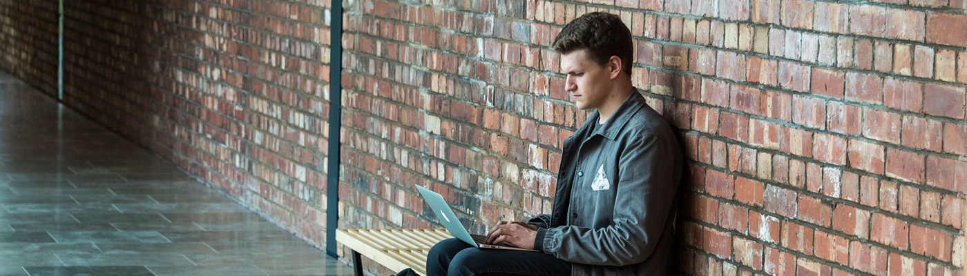 Man sat on laptop