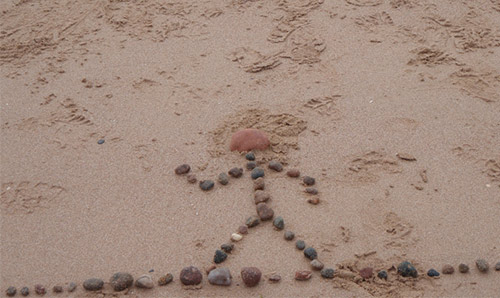 Creative Constraints CIDRAL theme (figure on a beach made from pebbles)
