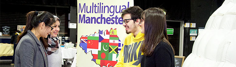 Multilingual Manchester stand at a JustFest event