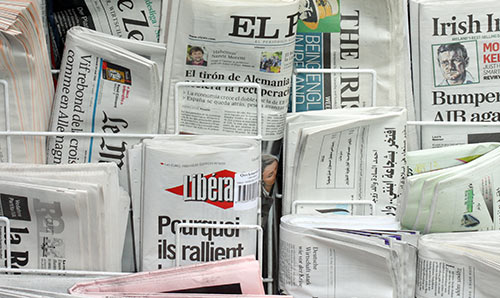 International newspapers on a news stand