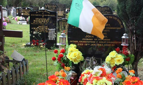 Modern cemetery with Irish flag