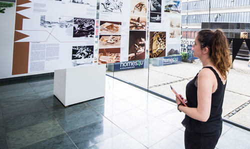 Postgraduate student looking at an exhibit in a muesuem