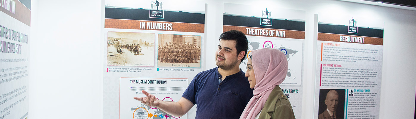 Students looking at display in history exhibit