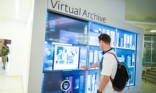 Male student using virtual archive screen