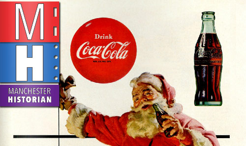 Father Christmas brandishing a bottle of Coca Cola