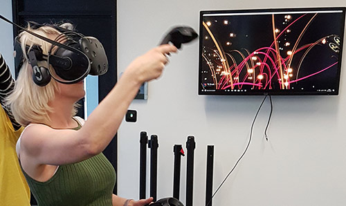 Female student using a virtual reality headset