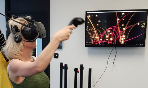 A female participant using a virtual reality headset