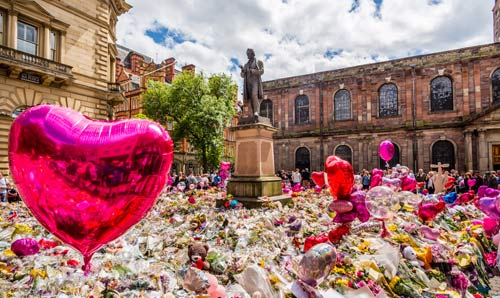 Photograph of the tributes in St Ann's Square to the dead and injured following the Manchester Arena attack in May 2017.  Photograph courtesy of Manchester City Council.