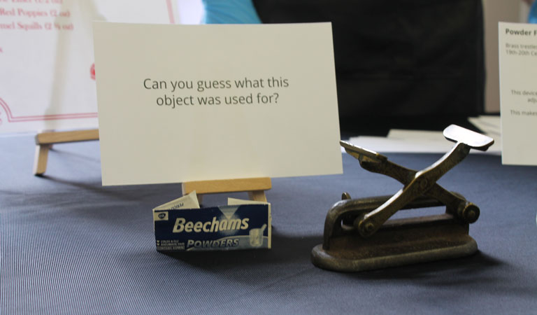 A mysterious medical object with a question card asking visitors to guess what it was used for.