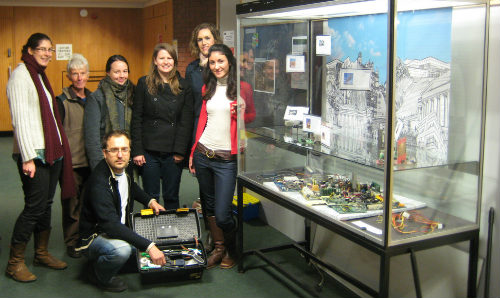 Students with their 'Small-scale Experimental Machine' display