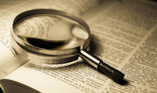 Magnifying glass on book