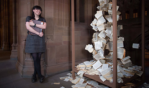 Guyda Armstrong (Senior Lecturer in Italian) with an exhibition at John Rylands Library