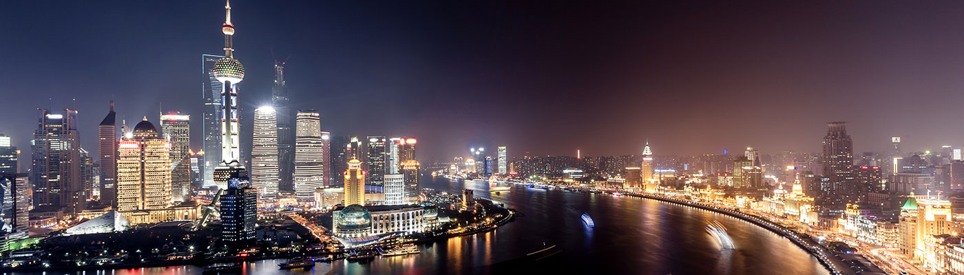 Shanghai skyscrapers and riverfront at night