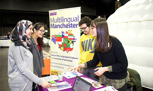 Multilingual Manchester pop-up stall at a careers fair