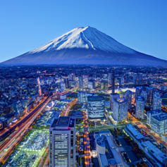 Mount Fuji looming over urban sprawl of Japanese city