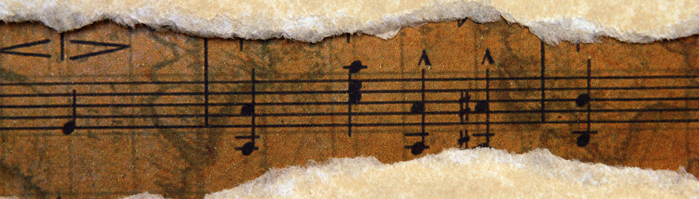 Old music script on torn paper