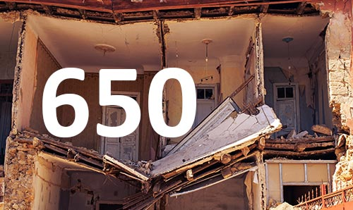 Number 650 written over photograph of collapsed building