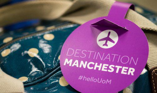 Bag label that says destination Manchester