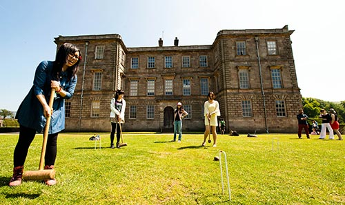 Students playing croquet at Lyme Park